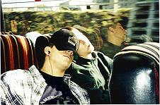 A photo of the boys sleeping on the bus.
